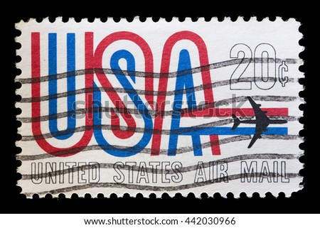 UNITED STATES OF AMERICA - CIRCA 1968: A used airmail postage stamp printed in United States shows an airplane flying over the word USA with national flag colors, circa 1968 - stock photo