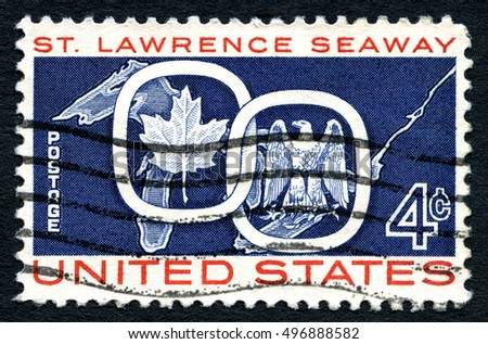 UNITED STATES OF AMERICA - CIRCA 1959: A used postage stamp from the USA celebrating the opening of St. Lawrence Seaway shows Maple Leaf with the American Eagle, circa 1959.
