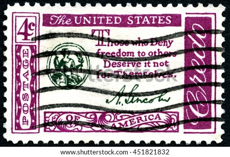 UNITED STATES OF AMERICA - CIRCA 1960: A used postage stamp from the USA, depicting a quote by President Lincoln promoting freedom, circa 1960. - stock photo