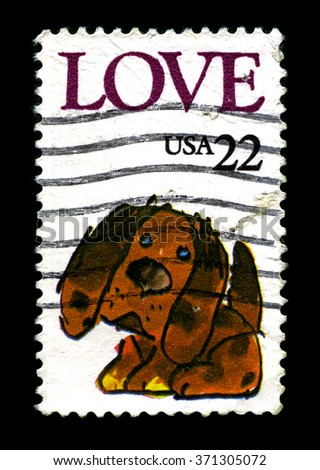 UNITED STATES OF AMERICA - CIRCA 1986: A used postage stamp printed in America, portraying LOVE and an illustration of a puppy, circa 1986. - stock photo