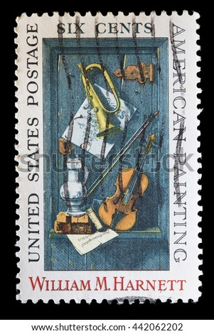 "UNITED STATES OF AMERICA - CIRCA 1969: A used postage stamp printed in United States shows a painting of William M. Harnett depicting the painting ""Old Models"" with music instruments, circa 1969"
