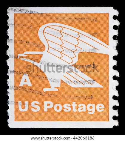 UNITED STATES OF AMERICA - CIRCA 1978: A used postage stamp printed in United States shows a stylized eagle and the words Domestic Mail on orange background, circa 1978 - stock photo