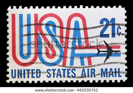 UNITED STATES OF AMERICA - CIRCA 1971: A used postage stamp printed in United States shows an airplane flying over the word USA with the colors of national flag, circa 1971