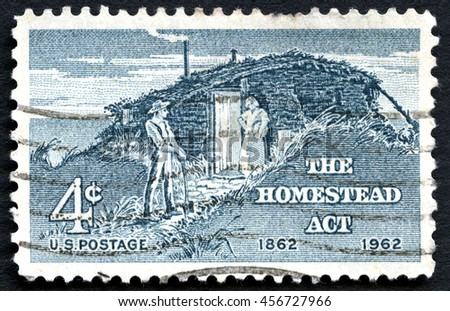 UNITED STATES OF AMERICA - CIRCA 1962: A used US postage stamp commemorating the 100th Anniversary since the 1862 Homestead Act, circa 1962. - stock photo