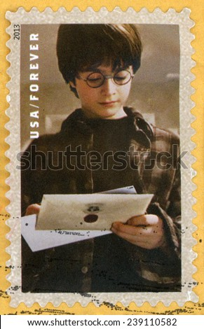 UNITED STATES OF AMERICA - CIRCA 2013: forever post stamp printed in USA shows Daniel Radcliffe as Harry Potter reading letter; scenes from Harry Potter movies; Scott 4825; circa 2013 - stock photo