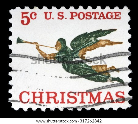 UNITED STATES OF AMERICA - CIRCA 1970s: A greeting Christmas stamp printed in the USA shows angel with horn, circa 1970s - stock photo
