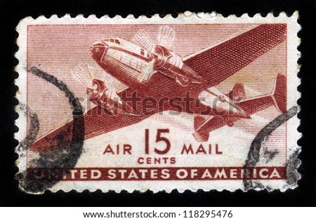 UNITED STATES OF AMERICA - CIRCA 1950s: A stamp printed in the USA shows two engine transport plane, circa 1950s - stock photo