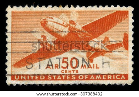 UNITED STATES OF AMERICA - CIRCA 1950s: A stamp printed in the USA shows two engine transport plane,  orange, series, circa 1950s - stock photo