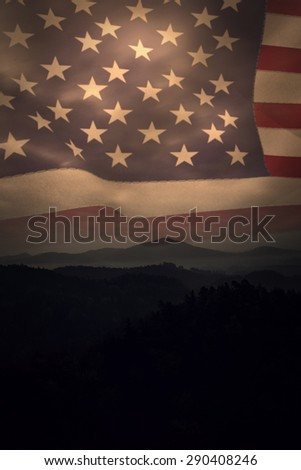 United states of america flag against trees and mountain range against cloudscape - stock photo