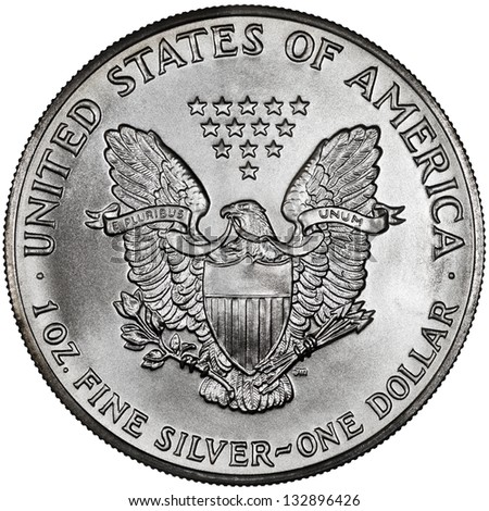 United States of America Silver Eagle One Dollar Coin Reverse Showing a Heraldic Eagle with Shield Isolated - stock photo