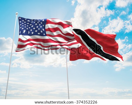 United States of America & Trinidad and Tobago Flags are waving in the sky