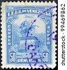 UNITED STATES OF VENEZUELA - CIRCA 1950: A stamp printed in Venezuela shows statue of Simon Bolivar in Caracas, circa 1950 - stock photo