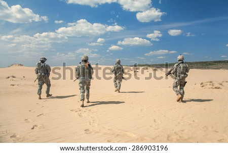 United States paratroopers airborne infantrymen in action in the desert - stock photo