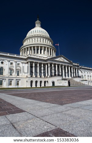 United States State Capitol under a beautiful blue sky in Washington, DC. - stock photo