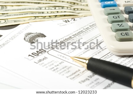 United States Tax Form, calculator, dollars and pen
