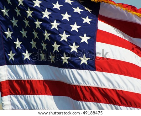 Unites States flag blowing in the wind