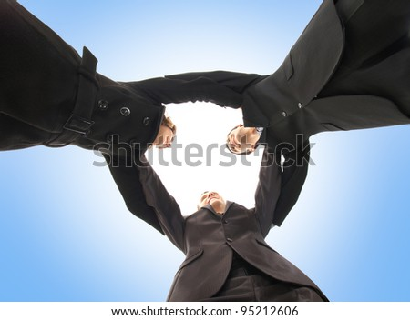 Unity of business people over blue  background - stock photo