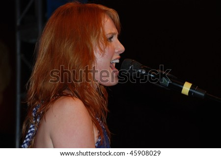 UNIVERSAL CITY, CA-AUGUST 29: Singer/actress Alicia Witt performs at Universal Citywalk Hollywood in Los Angeles as part of the summer concert series, August 29, 2009, in Universal City, CA.