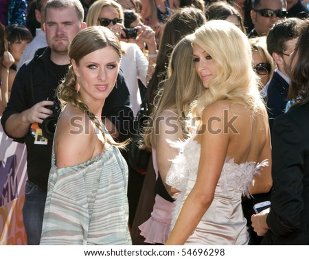 UNIVERSAL CITY, CA - JUNE 06: Paris and Nicky Hilton arrive on the Red Carpet at the 2010 MTV Movie Awards at Gibson Amphitheatre on June 6, 2010 in Universal City, CA. (Photo by Jonathan Nowak) - stock photo