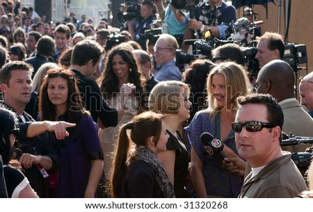UNIVERSAL CITY, CA - MAY 31: Actress Cameron Diaz amid a sea of reporters at the 2009 MTV Movie Awards Red Carpet at Gibson Amphitheatre in Universal City, California. - stock photo