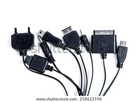 Universal USB cell phone charger on white background - stock photo