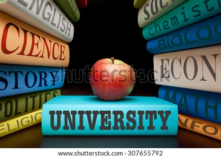 university education study books with text learning building knowledge with healthy apple - stock photo