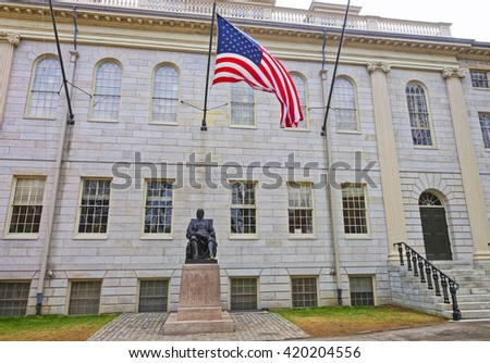 University Hall and John Harvard Statue in the campus of Harvard University in Cambridge, Massachusetts, MA, USA. It is a well-known monument of Harvard University founder in America. - stock photo