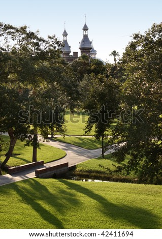 University of Tampa Park in morning light full of trees and green grass and walk ways - stock photo