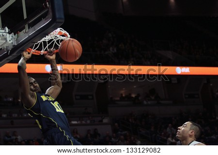 UNIVERSITY PARK, PA - FEBRUARY 27: Michigan's Tim Hardaway Jr. dunks against Penn State at the Byrce Jordan Center February 27, 2013 in University Park, PA - stock photo