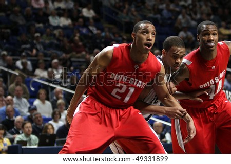 UNIVERSITY PARK, PA - FEBRUARY 24: Ohio State guards Evan Turner #21 and #44 William Bufford box out Penn State's D.J. Jackson at the Byrce Jordan Center February 24, 2010 in University Park, PA - stock photo