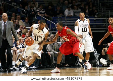 UNIVERSITY PARK, PA - FEBRUARY 24: Penn State's Bill Edwards #11 tries to drive around #44 William Bufford against Ohio State at the Byrce Jordan Center February 24, 2010 in University Park, PA - stock photo