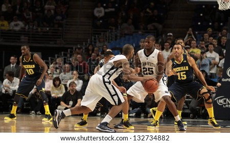 UNIVERSITY PARK, PA - February 27: Penn State's D. J. Newbill looks for an opening  as John Grahamn sets a screen against Michigan at the Byrce Jordan Center February 27, 2013 in University Park, PA