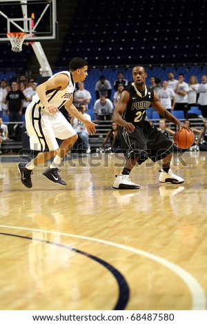 UNIVERSITY PARK, PA - JANUARY 5: Purdue's point guard Lewis Jackson dribbles the ball as Talor Battle defends at the Byrce Jordan Center January 5, 2011 in University Park, PA
