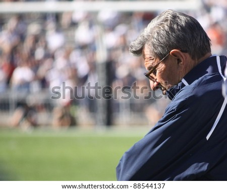 UNIVERSITY PARK, PA - OCT 9: Penn State coach Joe Paterno looks down during a loss to Illinois at Beaver Stadium October 9, 2010 in University Park, PA - stock photo