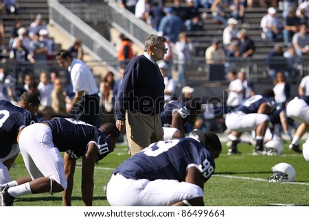 UNIVERSITY PARK, PA - OCT 9: Penn State coach Joe Paterno walks among his players prior to the start of a game against Illinois at Beaver Stadium on October 9, 2010 in University Park, PA - stock photo