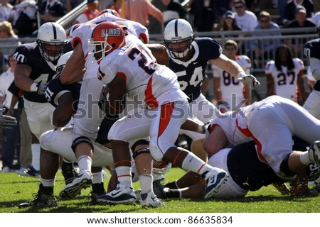 UNIVERSITY PARK, PA - OCT 9: Penn State linebacker (No. 40) Glenn Carson closes in on Illinois Running back during a game with Illinois at Beaver Stadium on October 9, 2010 in University Park, PA - stock photo