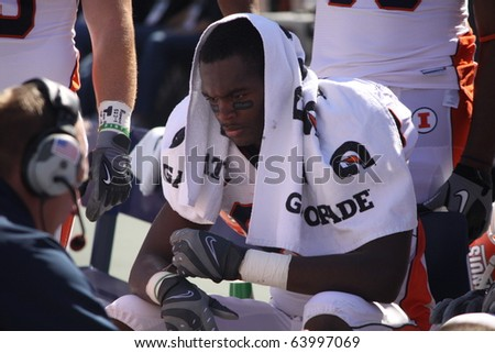 UNIVERSITY PARK, PA - OCT 9: Unidentified Illinois player talks to an assistant coach during a game against Penn State at Beaver Stadium October 9, 2010 in University Park, PA - stock photo