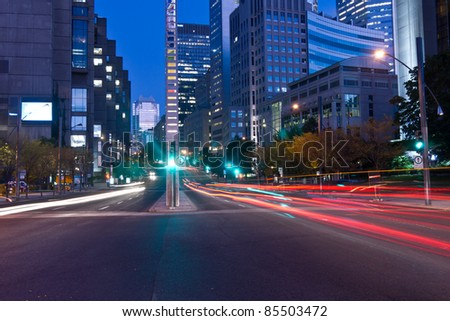 University Street in Montreal with silhouette cars with red rear light and traffic light, early morning to dusk. # 2 - stock photo
