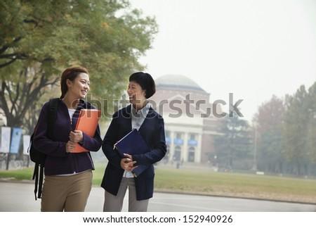 University Student and Professor on Campus - stock photo