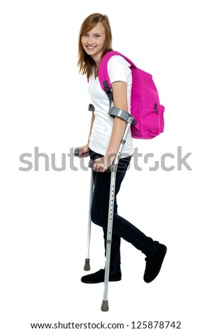 University student walking with help of crutches. Accidental case. - stock photo
