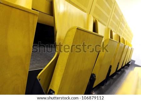 university yellow lecture hall - stock photo