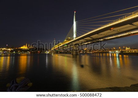 Unkapani subway bridge stretching over golden horn bay in istanbul during night.