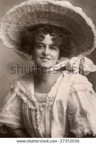 UNKNOWN - CIRCA 1911: An unidentified woman wears a large Easter bonnet in this Victorian Era portrait circa 1911 taken in an unknown location. - stock photo