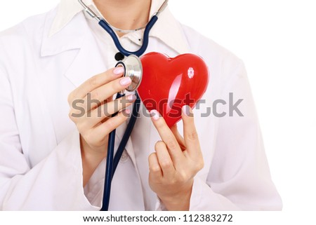 Unknown female doctor standing with stethoscope and red heart symbol isolated on white background - stock photo
