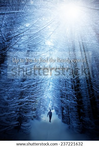 unknown motivational quote background with man walk in deep winter forest and text above  - stock photo