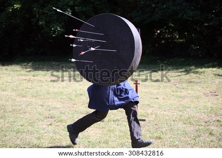Unknown warrior on a historical medieval combat show - stock photo