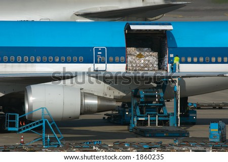 unloading cargo from a big plane - stock photo