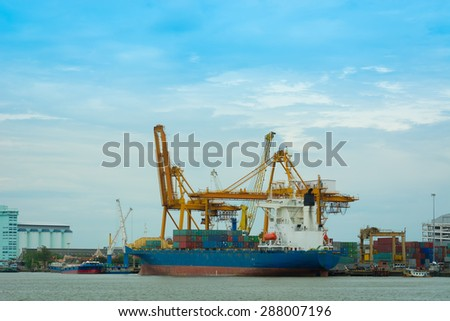 Unloading container cargo ship. - stock photo