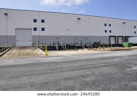 unloading docks for a large industrial warehouse - stock photo
