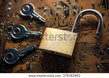 unlock security lock on a computer circuit board surrounded by keys / random password hacking concept - stock photo